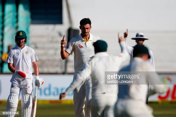 Australia bowler Mitchell Starc celebrates the wicket of South Africa batsman Theunis de Bruyn during day two of the first Test cricket match between...