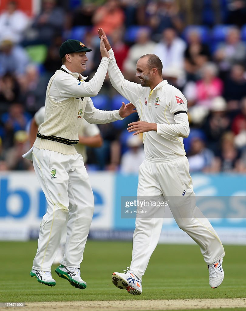 Australia bowler Nathan Lyon ( right) celebrates after dismissing Alastair Cook during day one of the 1st Investec Ashes Test match between England and Australia at SWALEC Stadium on July 8, 2015 in Cardiff, United Kingdom.