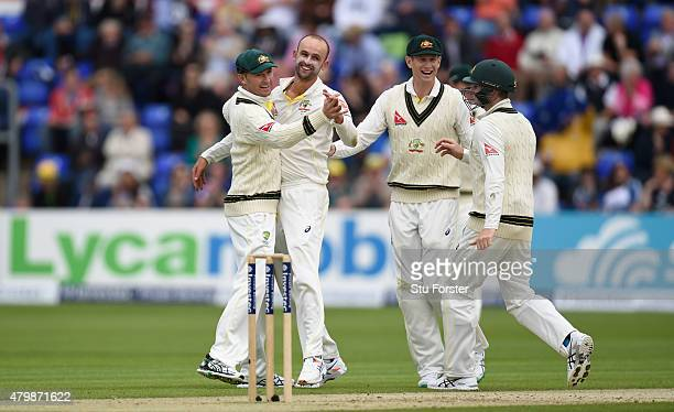 Australia bowler Nathan Lyon celebrates with Michael Clarke after dismissing Alastair Cook during day one of the 1st Investec Ashes Test match...