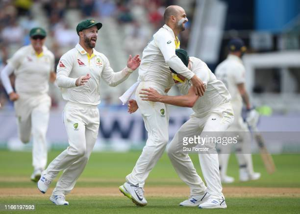 Australia bowler Nathan Lyon celebrates with team mates after dismissing Ben Stokes during the fifth day of the 1st Test match between England and...
