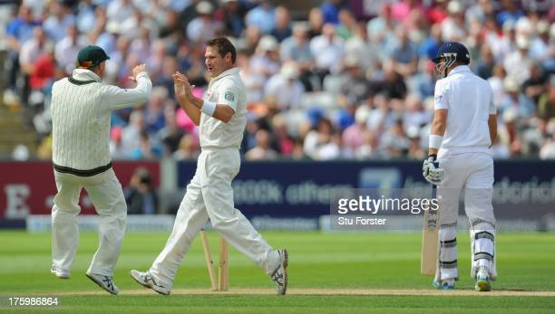 Australia bowler Ryan Harris celebrates after bowling Joe Root with David Warner during day three of 4th Investec Ashes Test match between England...