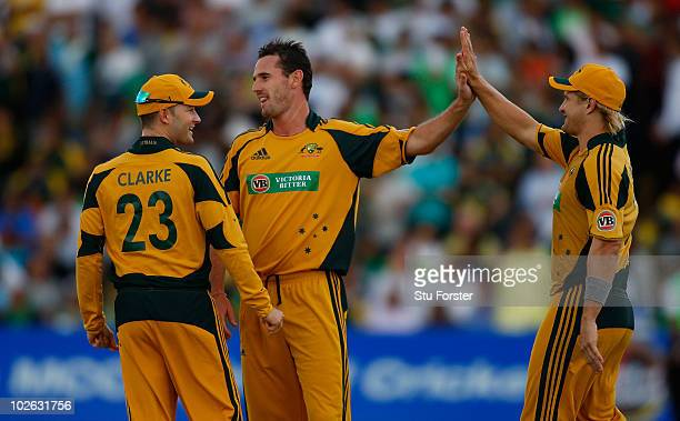 Australia bowler Shaun Tait celebrates a wicket with Shane Watson and Michael Clarke during the 1st Twenty20 International between Pakistan and...