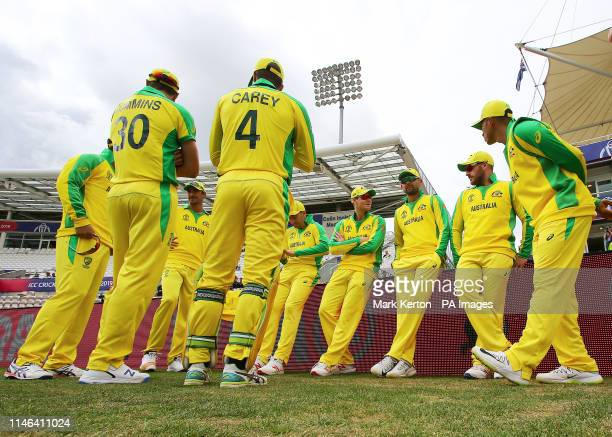 Australia captain Aaron Finch talks with his team as they wait to start the ICC Cricket World Cup Warm up match at the Hampshire Bowl Southampton