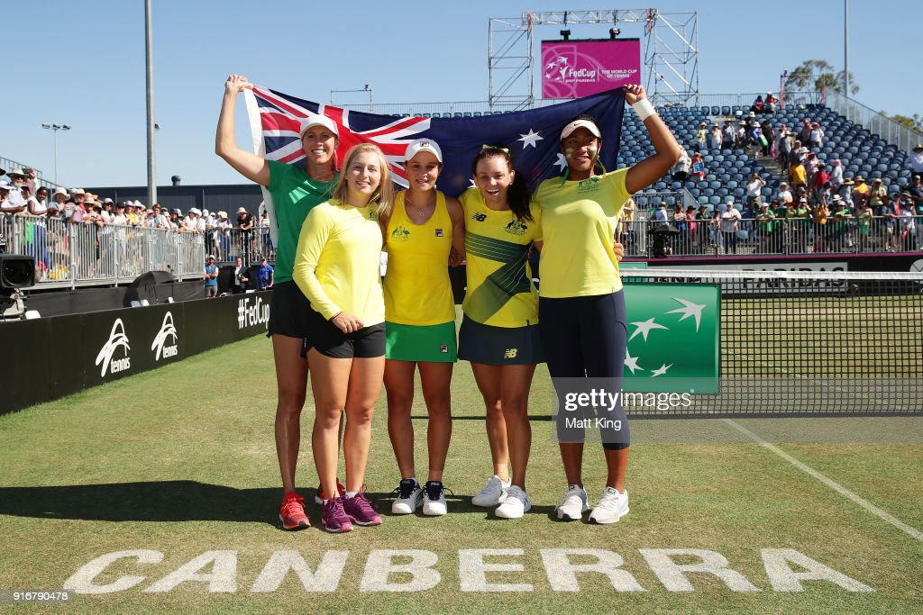 Australia captain Alicia Molik, Daria Gavrilova, Ashleigh Barty, Casey Dellacqua and Destanee Aiava of Australia celebrate victory during the Fed Cup tie between Australia and the Ukraine at the Canberra Tennis Centre on February 11, 2018 in Canberra, Australia.