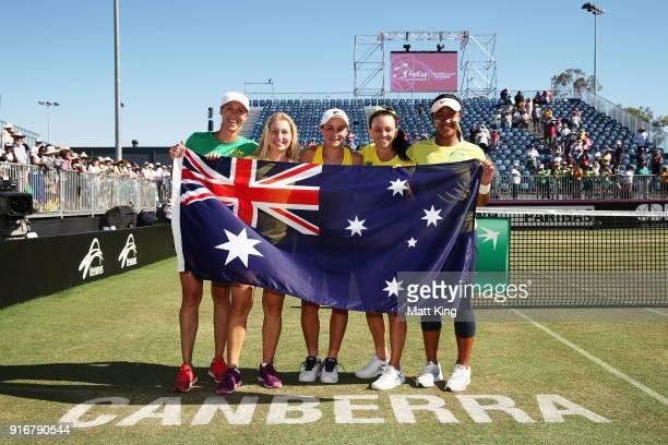 Australia captain Alicia Molik Daria Gavrilova Ashleigh Barty Casey Dellacqua and Destanee Aiava of Australia celebrate victory during the Fed Cup...