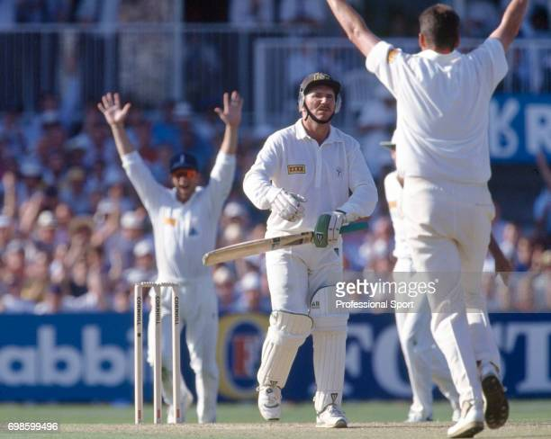 Australia captain Allan Border walks off after being dismissed for 48 by Angus Fraser of England during the 6th Test match between England and...