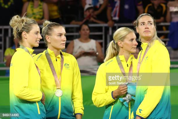 Australia captain Caitlin Bassett and her teammates look on during the medal ceremony for the Netball Gold Medal Match on day 11 of the Gold Coast...