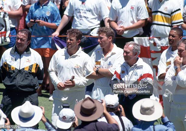 Australia captain Mark Taylor standing next to England captain Mike Atherton holds on to the Ashes urn at the end of the 5th Test match between...