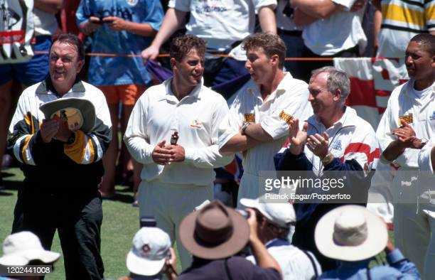 Australia captain Mark Taylor talks to England captain Mike Atherton while holding the Ashes urn during the presentation ceremony at the end of the...