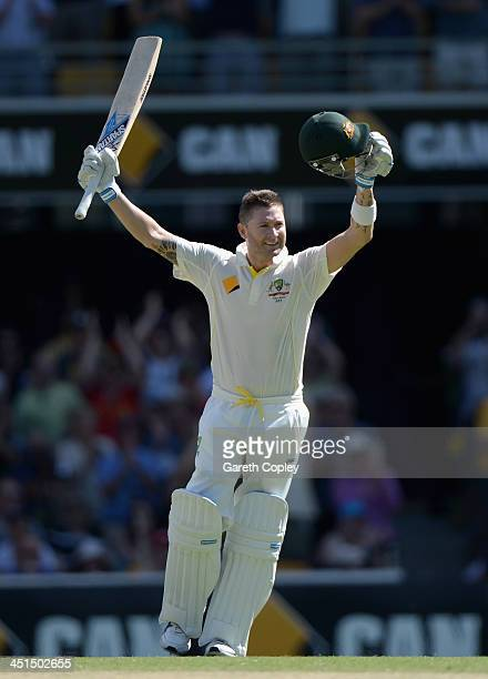 Australia captain Michael Clarke celebrates reaching his century during day three of the First Ashes Test match between Australia and England at The...