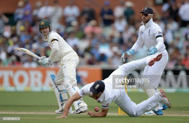 Australia captain Michael Clarke hits past England captain Alastair Cook and wicketkeeper Matt Prior during day two of the Second Ashes Test Match...