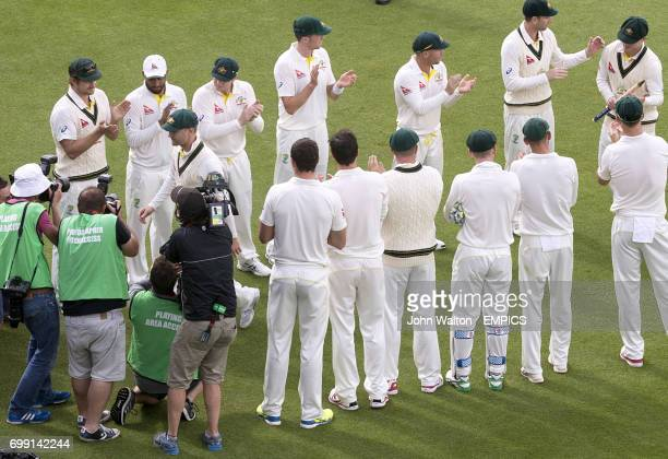 Australia captain Michael Clarke is given a guard of honour as he walks from the field of play