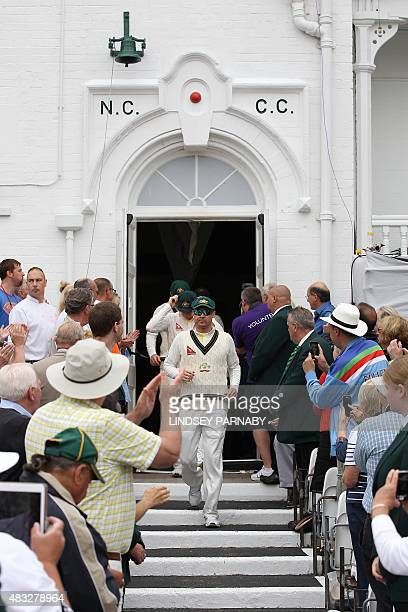 Australia captain Michael Clarke leads his team out of the pavillion for play on the second day of the fourth Ashes cricket Test match between...