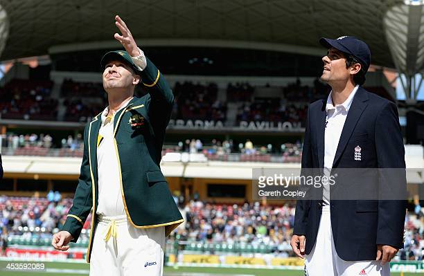 Australia captain Michael Clarke tosses the coin alongside England captain Alastair Cook ahead of day one of the Second Ashes Test Match between...