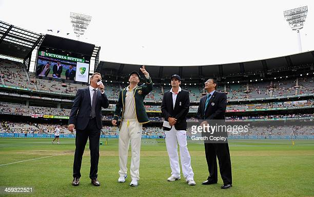 Australia captain Michael Clarke tosses the coin alongside England captain Alastair Cook ahead of day one of the Fourth Ashes Test Match between...