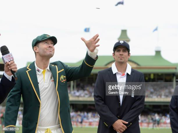 Australia captain Michael Clarke tosses the coin alongside England captain Alastair Cook ahead day one of the Fifth Ashes Test match between...