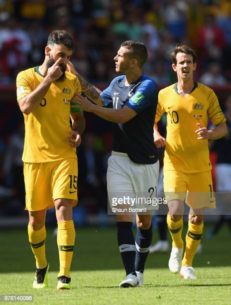 Australia captain Mile Jedinak and Lucas Hernandez of France discuss the VAR decision during the 2018 FIFA World Cup Russia group C match between...