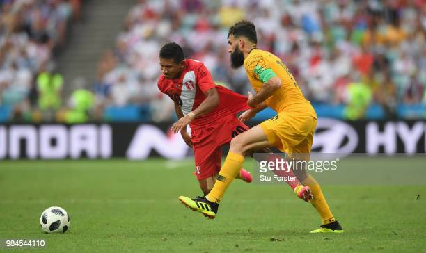 Australia captain Mile Jedinak fouls Edison Flores of Peru during the 2018 FIFA World Cup Russia group C match between Australia and Peru at Fisht...