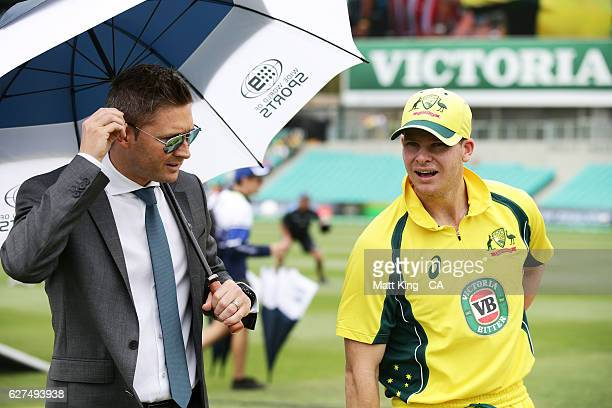 Australia captain Steve Smith talks to Michael Clarke prior to game one of the One Day International series between Australia and New Zealand at...