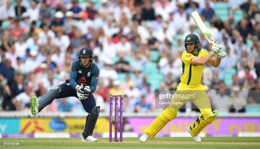 Australia captain Tim Paine bats watched by England wicketkeeper Jos Buttler during the 1st Royal London ODI match between England and Australia at The Kia Oval on June 13, 2018 in London, England.