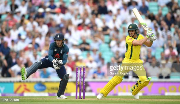 Australia captain Tim Paine bats watched by England wicketkeeper Jos Buttler during the 1st Royal London ODI match between England and Australia at...