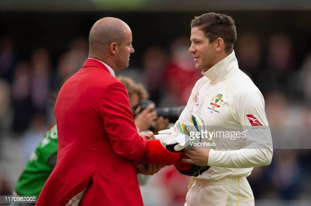 Australia captain Tim Paine gives his special edition cap to Andrew Strauss on the inaugral Ruth Strauss Foundation day prior to day two of the 2nd...