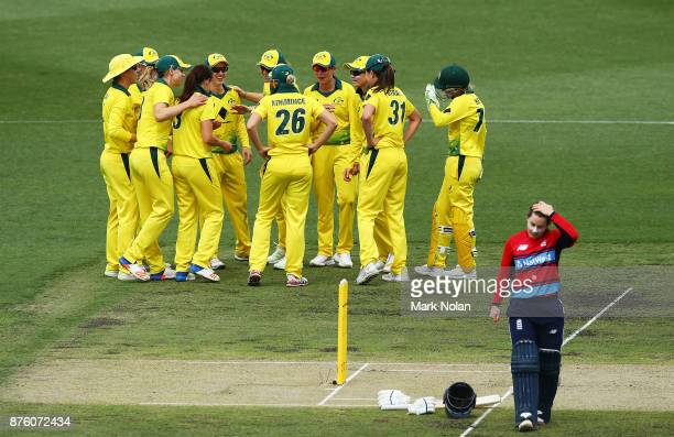 Australia celebrate a wicket by Megan Schutt during the second Women's Twenty20 match between Australia and England at Manuka Oval on November 19...