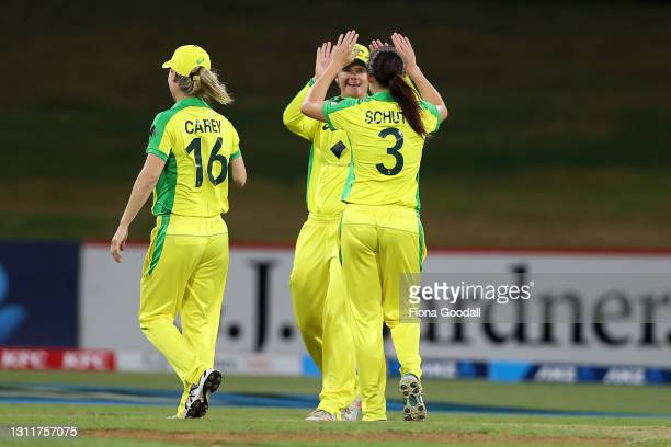 Australia celebrate a wicket during game three of the One Day International series between the New Zealand White Ferns and Australia at Bay Oval on...