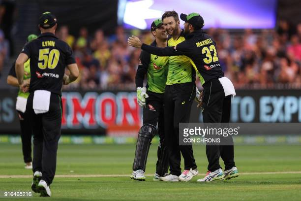 Australia celebrate after Andrew Tye bowled out England's Jos Buttler during the Twenty20 International TriSeries cricket match between England and...