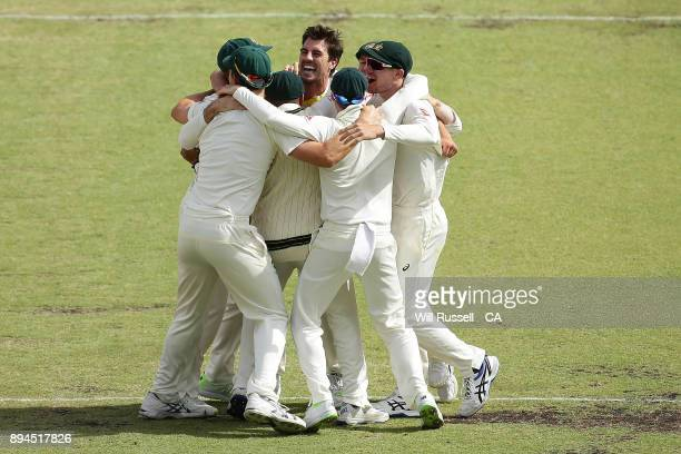 Australia celebrate after defeating England to retake the Ashes during day five of the Third Test match during the 2017/18 Ashes Series between...