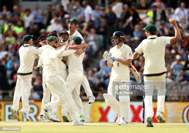 Australia celebrate after Pat Cummins of Australia claimed the final wicket of Chris Woakes of England to claim victory during day five of the Third...