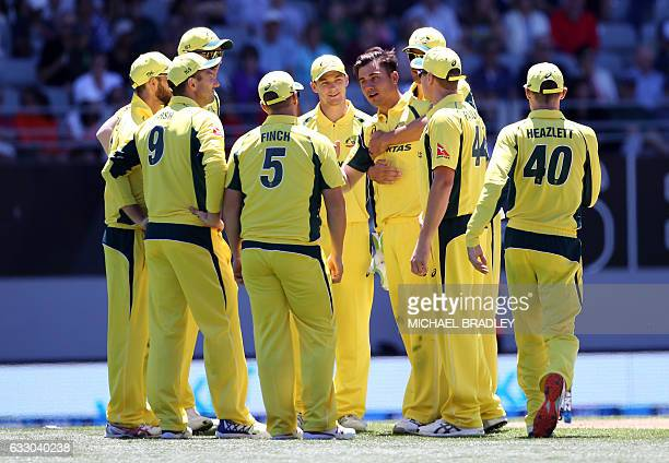 Australia celebrate after taking the wicket of Martin Guptill of New Zealand during the oneday international cricket match between New Zealand and...