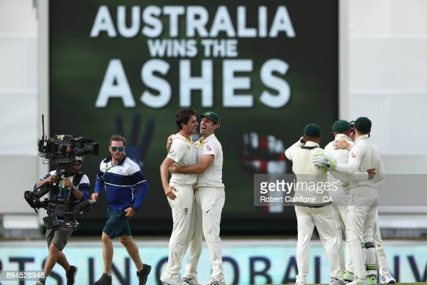 Australia celebrate after they defeated England to win the Ashes during day five of the Third Test match during the 2017/18 Ashes Series between...