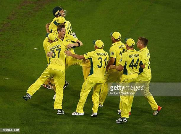 Australia celebrate after they defeated New Zealand during the 2015 ICC Cricket World Cup final match between Australia and New Zealand at Melbourne...