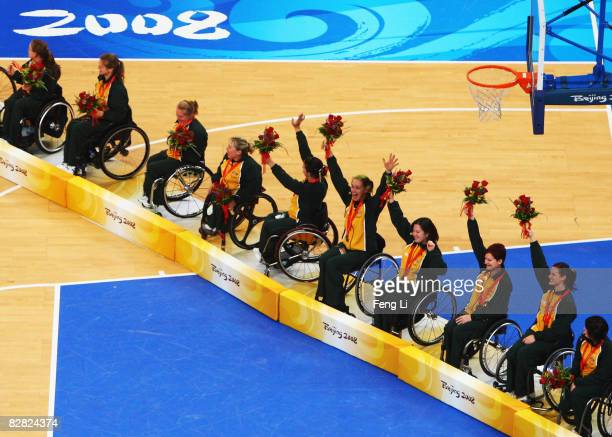 Australia celebrate after winning the Bronze in the Women's Wheelchair Basketball match at the National Indoor Stadium during day nine of the 2008...