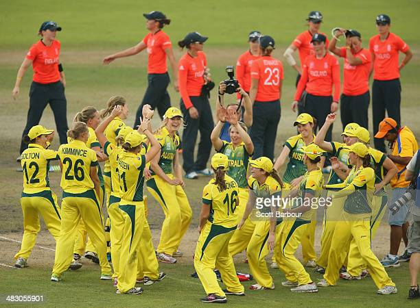 Australia celebrate after winning the Final as England look on during the ICC Women's World Twenty20 Bangladesh 2014 between Australia Women and...