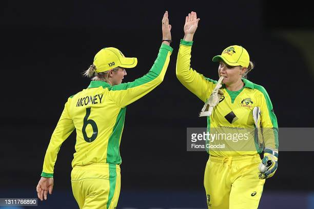 Australia celebrate during game three of the One Day International series between the New Zealand White Ferns and Australia at Bay Oval on April 10,...