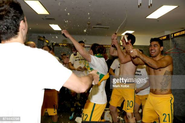 Australia celebrate in the change room after victory during the 2018 FIFA World Cup Qualifiers Leg 2 match between the Australian Socceroos and...