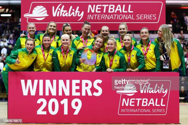 Australia celebrate on the podium after they win the Vitality Netball International Series match between England Vitality Roses and Australian...