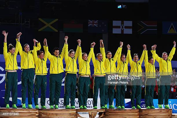 Australia celebrate on the podium after winning the gold medal match between Australia and New Zealand at SECC Precinct during day eleven of the...