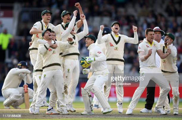 Australia celebrate the final wicket of Craig Overton of England to win the Test Match and retain the Ashes during Day Five of the 4th Specsavers...