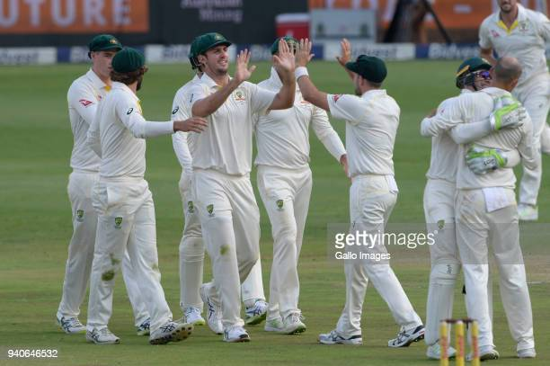 Australia celebrate the wicket of Hashim Amla of the Proteas during day 3 of the 4th Sunfoil Test match between South Africa and Australia at Bidvest...