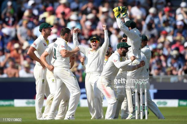 Australia celebrate the wicket of Stuart Broad of England during day four of the 3rd Specsavers Ashes Test match between England and Australia at...