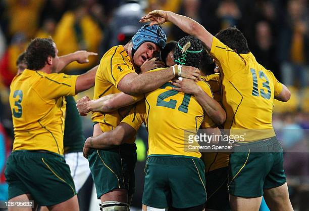 Australia celebrate their 11-9 victory as the final whistle blows during quarter final three of the 2011 IRB Rugby World Cup between South Africa and...
