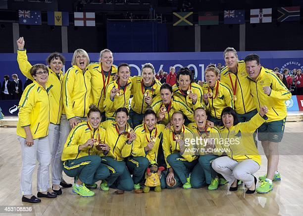Australia celebrate their gold medal after defeating New Zealand in the netball gold medal match at The Hydro venue during the 2014 Commonwealth...