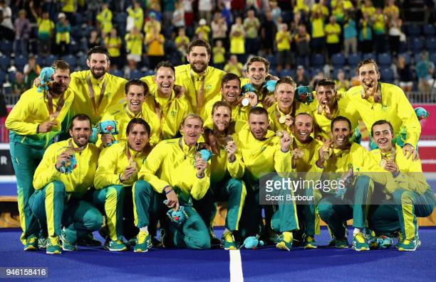 Australia celebrate their gold medal on the podium following the Men's gold medal match between Australia and New Zealand during Hockey on day 10 of...