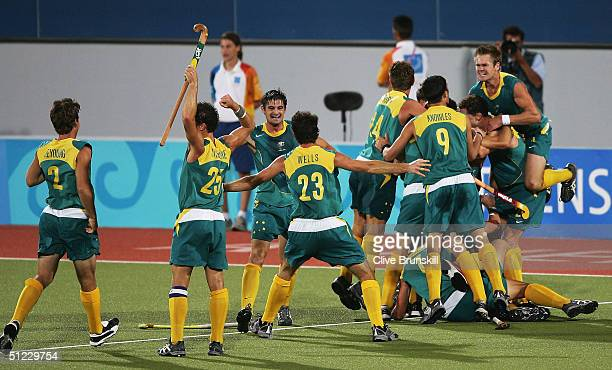 Australia celebrate their gold medal win after a Jamie Dwyer goal in extra time sealed the win in the men's field hockey event on August 27, 2004...