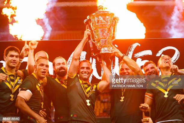 Australia celebrate their victory at the end of the rugby league World Cup men's final match between Australia and England in Brisbane on December 2...