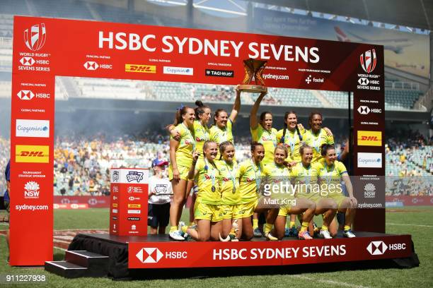 Australia celebrate victory after defeating New Zealand in the Women's Final match during day three of the 2018 Sydney Sevens at Allianz Stadium on...