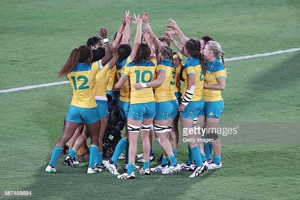 Australia celebrate victory after winning the Women's Gold Medal Final Rugby Sevens match between Australia and New Zealand on August 8 2016 in Rio...